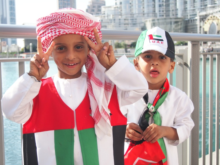 These cute boys enjoyed being photographed on National Day!